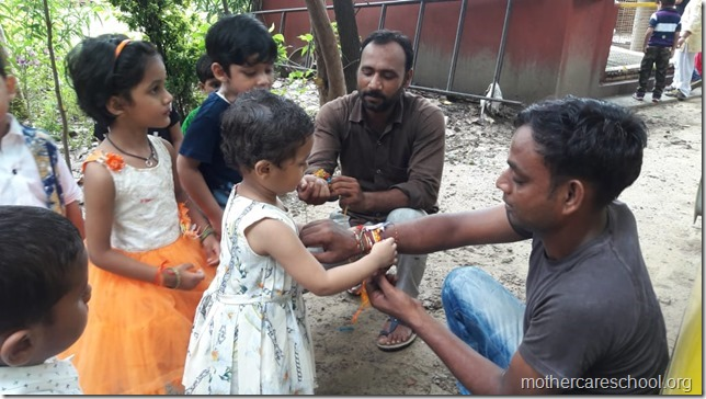 Playgroup children  learning about gratitude to those who nurture and care for us like the teachers, ayahs, van bhayiyas, trees and plants and Moolchand mali bhaiya by tying rakhis (2)